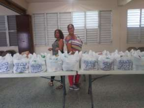 Cook & driver with groceries to distribute
