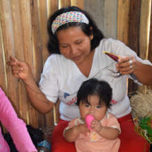 Sarita weaving bird with baby in Chino workshop
