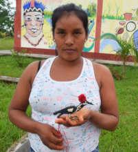 Bora artisan Kori with woodpecker ornament