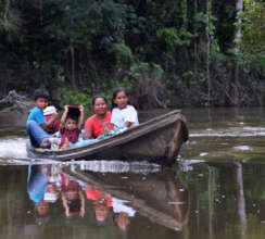 8. Family in peque-peque en route to village
