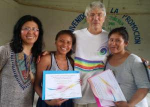 Facilitators giving participant a certificate