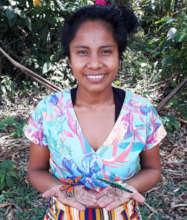 Artisan with woven butterflies at Estiron workshop