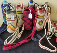 Bottle carriers at practice fair for tourists