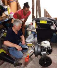 Chris adjusting shredder with CACE coordinator