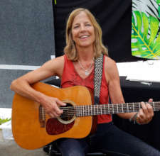 Colleen Kattau playing with Amazon guitar strap
