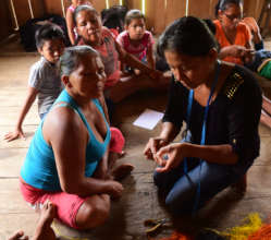 Doilith showing artisan to make woven butterfly