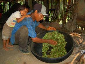 Don Manuel toasting coca leaves