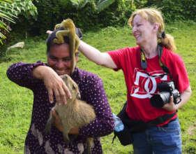Donna with artisan, capybara and squirrel monkey
