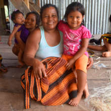 Bora artisan with woven bag and daughter /CACE