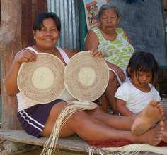 Bora artisan with woven chambira fiber placemats