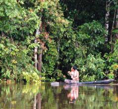 Bora fisherman in canoe on Yaguasyacu River