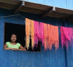 Bora artisan drying dyed chambira palm fiber