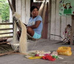 Bora artisan in hammock with chambira fiber