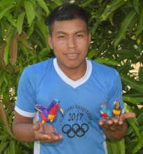 Heriberto with bird ornaments