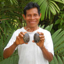 Lucio with carved calabash rattle ornaments