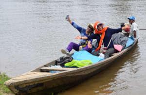Facilitators in boat en route to Brillo Nuevo