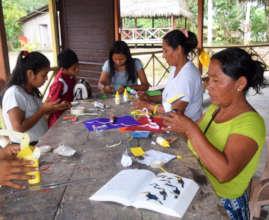 Artisans making paper toucans at workshop in Nauta