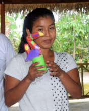 Artisan showing toucan made by her group