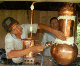 First distillation of copal resin in alembique pot