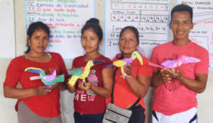 Artisans showing toucans made by groups in round 2