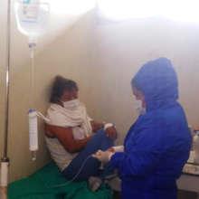 Health post technician treating COVID patient