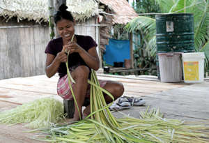 Bora artisan Maria stripping chambira leaf fiber