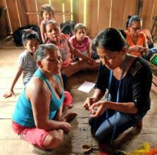 Native artisans learning to make woven butterflies