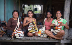 Bora native artisans with woven bottle holders