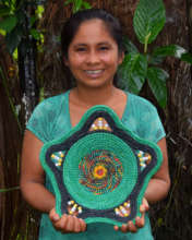 Chino artisan with woven chambira basket