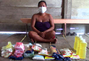 Bora woman with CACE relief supplies