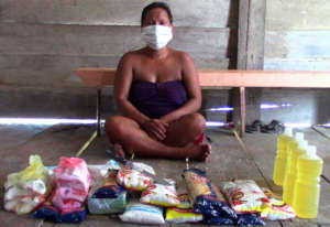 Bora woman with donated COVID relief supplies