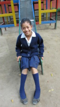 Clara enjoys playing on the school playground