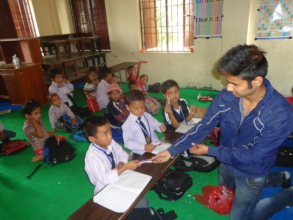 Distributing chocolate on national Children's day