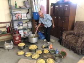 CDC Chairperson  preparing  feasts for the kids