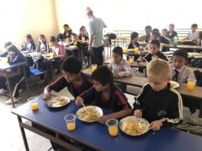 CDC chairman serving food  tot he kids