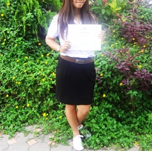 Tai Holding Her FirstClassHonors Certificate