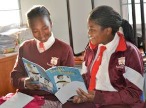 Learners engaged in book club reading session
