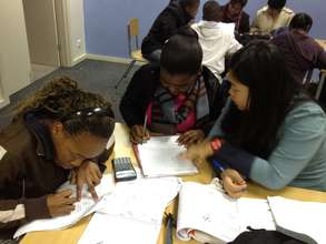 International volunteers helping learners