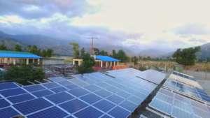 Power lines run above the solar array again!