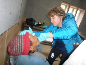 Dr. Astrid caring for a patient April 2018