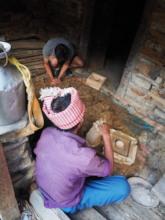HHC Bin Thapa helping make stove bricks, Tipling