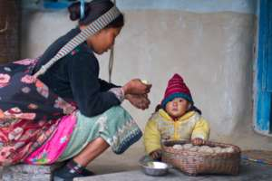 A mother with her baby in the Dhading villages