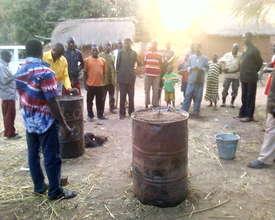 Tilo villagers and Kosguelbe Team observing.