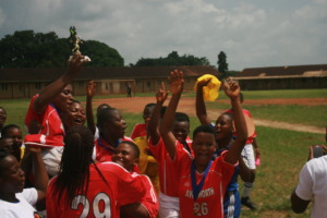 Kumba girls raising the Super Cup!