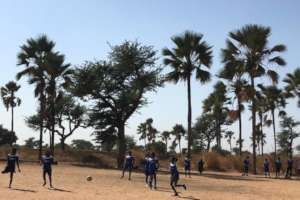 Girls play a soccer tournament game in Thies