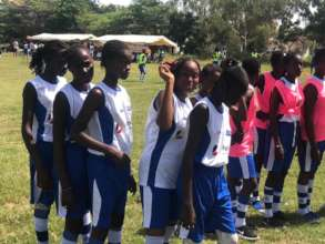 Girls line up to do soccer drills in Thies
