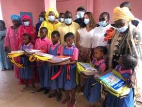 Girls receive schools supplies from Ladies' Turn