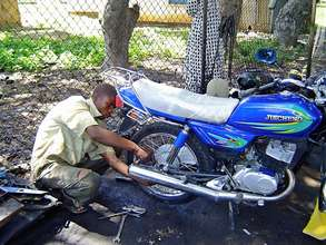 Motorcycle beneficiary at work