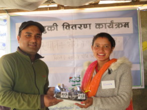 Local woman receiving solar tuki lamp