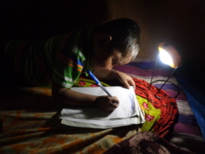 "A child studying using solar lamp ""Pico"""